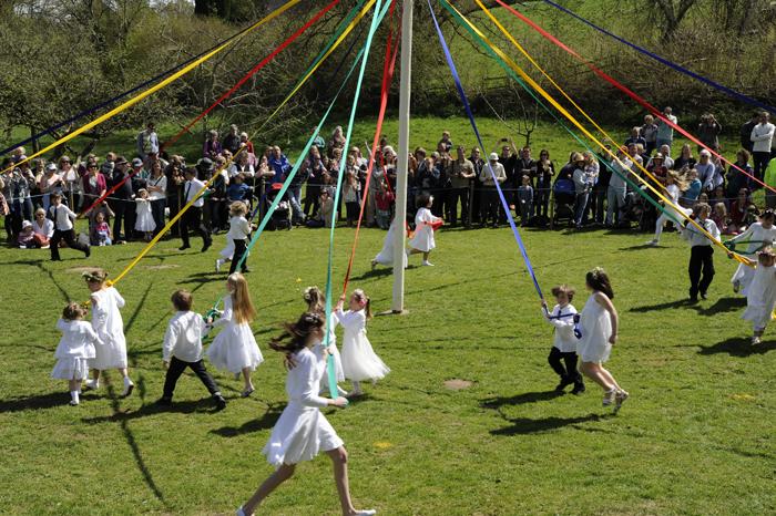 CHILDREN DANCING  AROUND THE LUSTLEIGH MAYPOLE ROBERT HESKETH 8